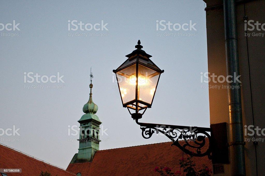Lit lantern and church spire, Old Town, Zagreb, Croatia stock photo