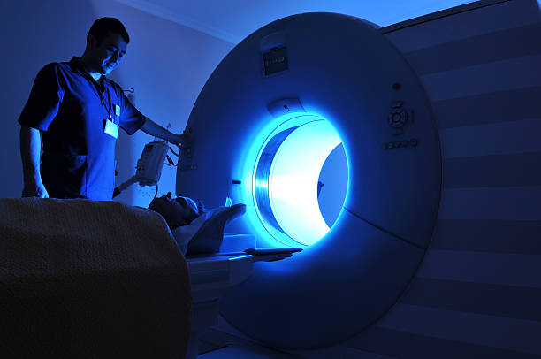Lit magnetic resonance imaging machine stock photo