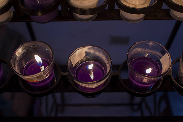 Lit purple Candle stock photo