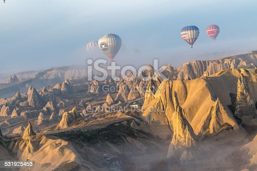 istock lit rocky formations overflown by balloons filled with tourists 531925453