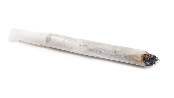 Lit self-made joint on a white background stock photo