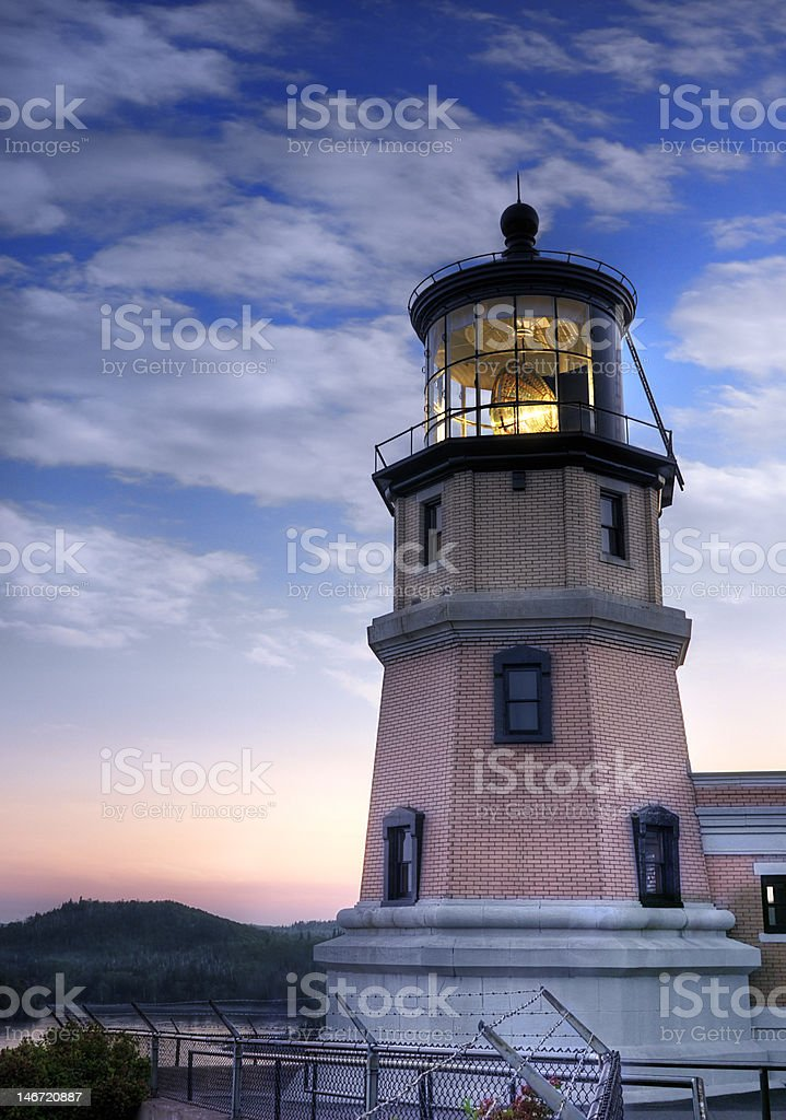 Lit Split Rock Lighthouse and Sunset stock photo