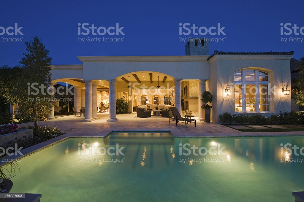Lit Swimming Pool And Building Exterior stock photo