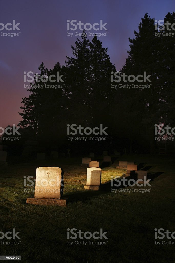 Lit Up Cemetary at Night royalty-free stock photo