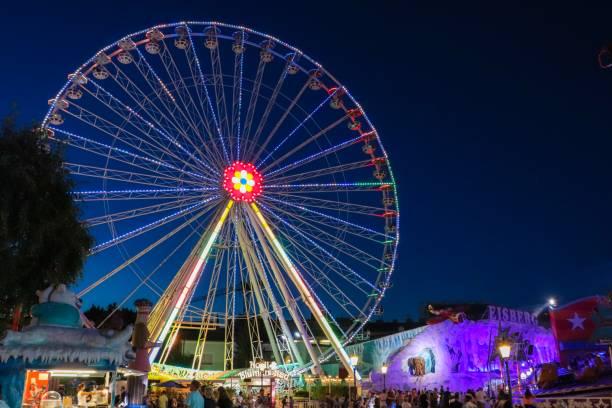 Lit up ferris wheel in theme park vienna picture id1128740556?b=1&k=6&m=1128740556&s=612x612&w=0&h=dniwzkf6xqpw3mlmpw4jn1qvrlkarkn2ag6u anykq8=