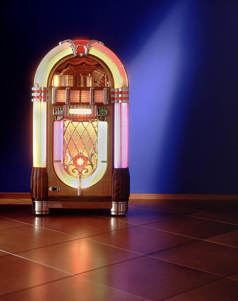 lit up jukebox against a blue wall - pikap stok fotoğraflar ve resimler