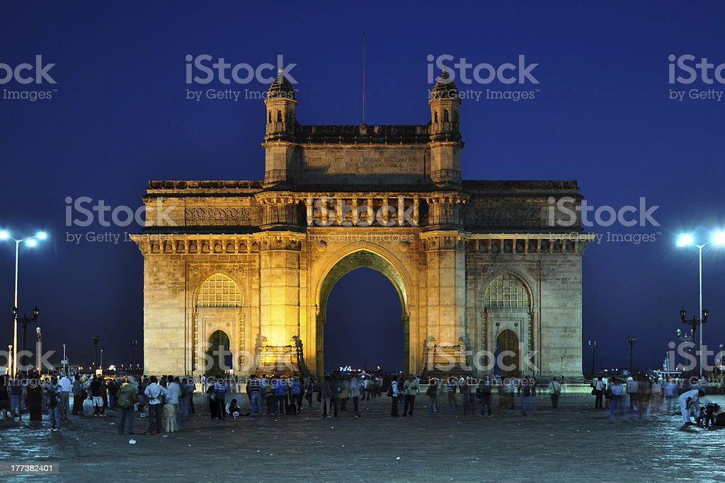 A lit up photograph of the Gateway of India at night stock photo