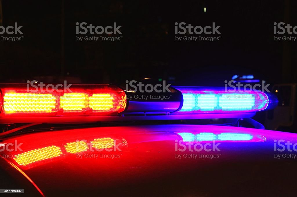 Lit up police car lights during nighttime stock photo