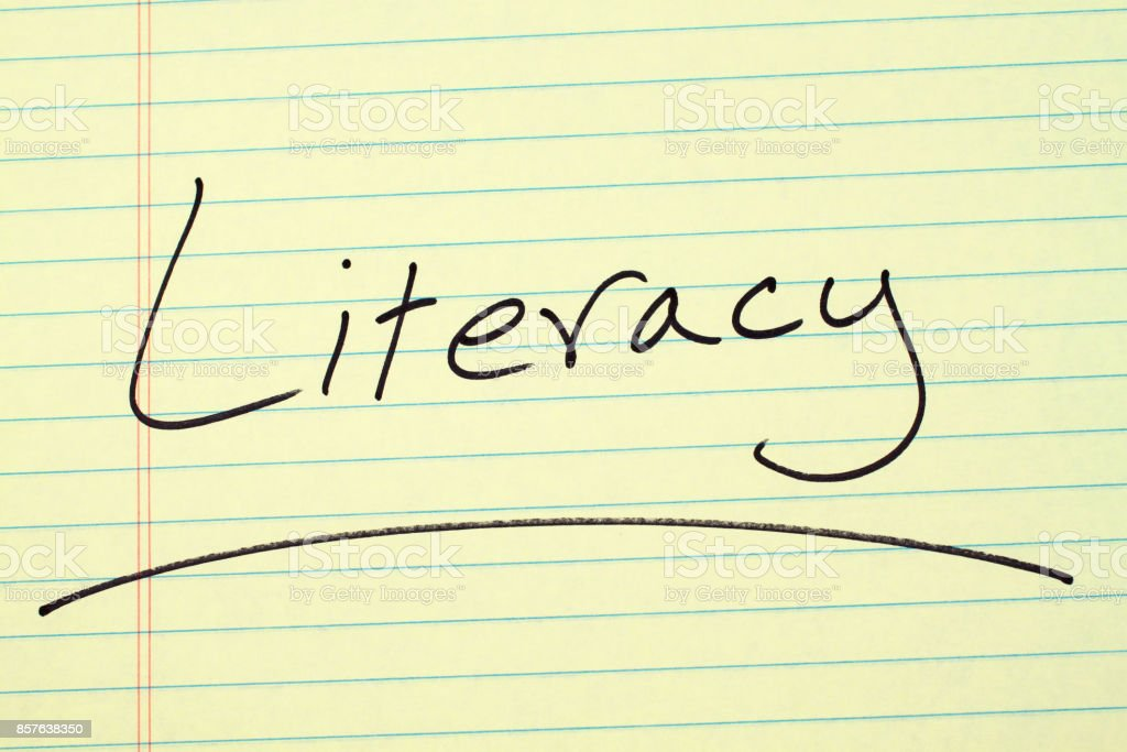 Literacy On A Yellow Legal Pad stock photo