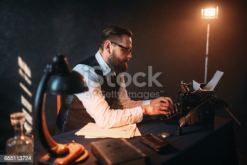 655113470istockphoto Literature author in glasses typing on typewriter 655113724