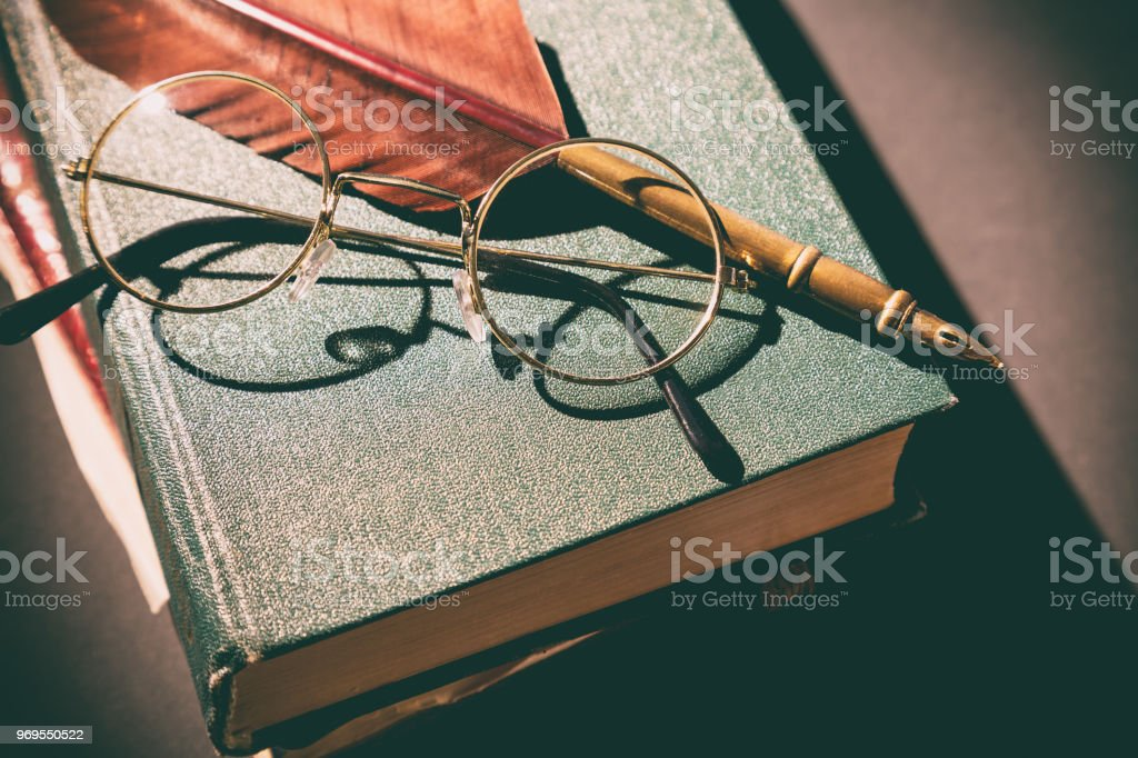 Literature concept. Vintage still life with glasses on old books near...