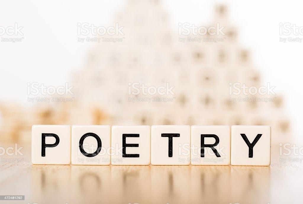 Literature. Poetry word on wood blocks stock photo