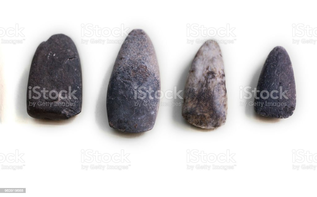 Lithic tools. Four stone chisels stock photo