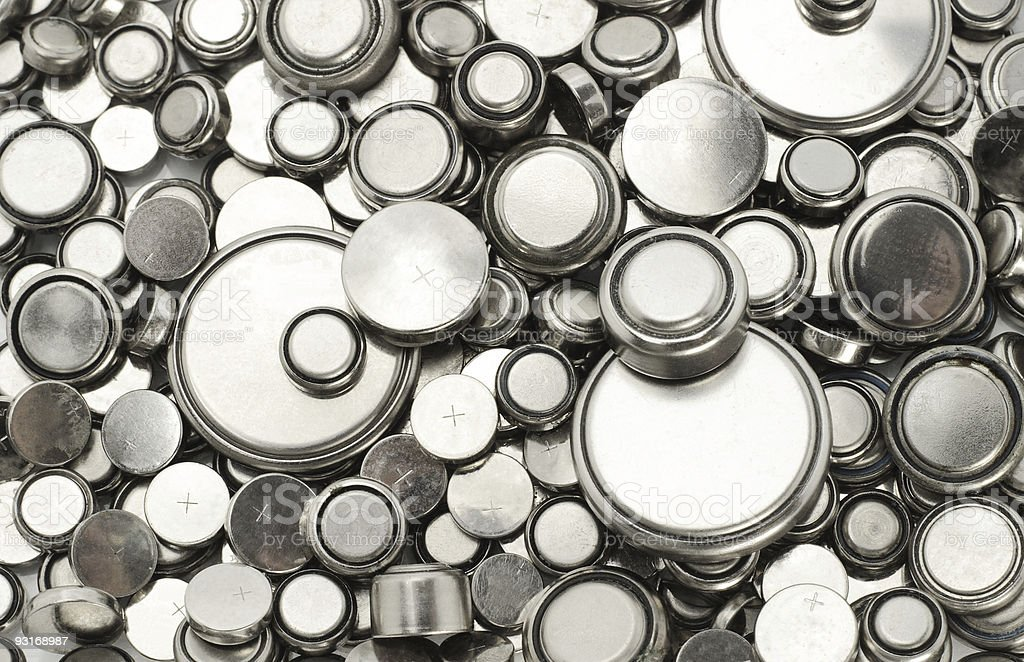 Lithium batteries of various sizes stock photo