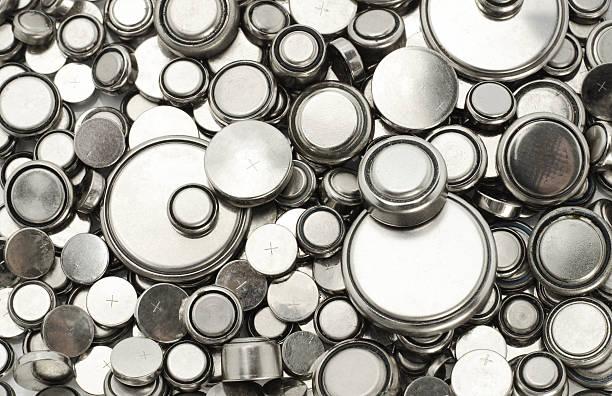 Lithium batteries of various sizes stock photo
