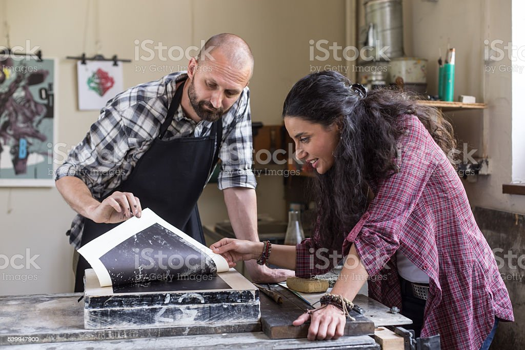 Lithography workers enjoying their handmade product stock photo