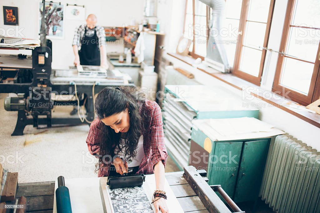 Lithography workers handmaking at workshop stock photo
