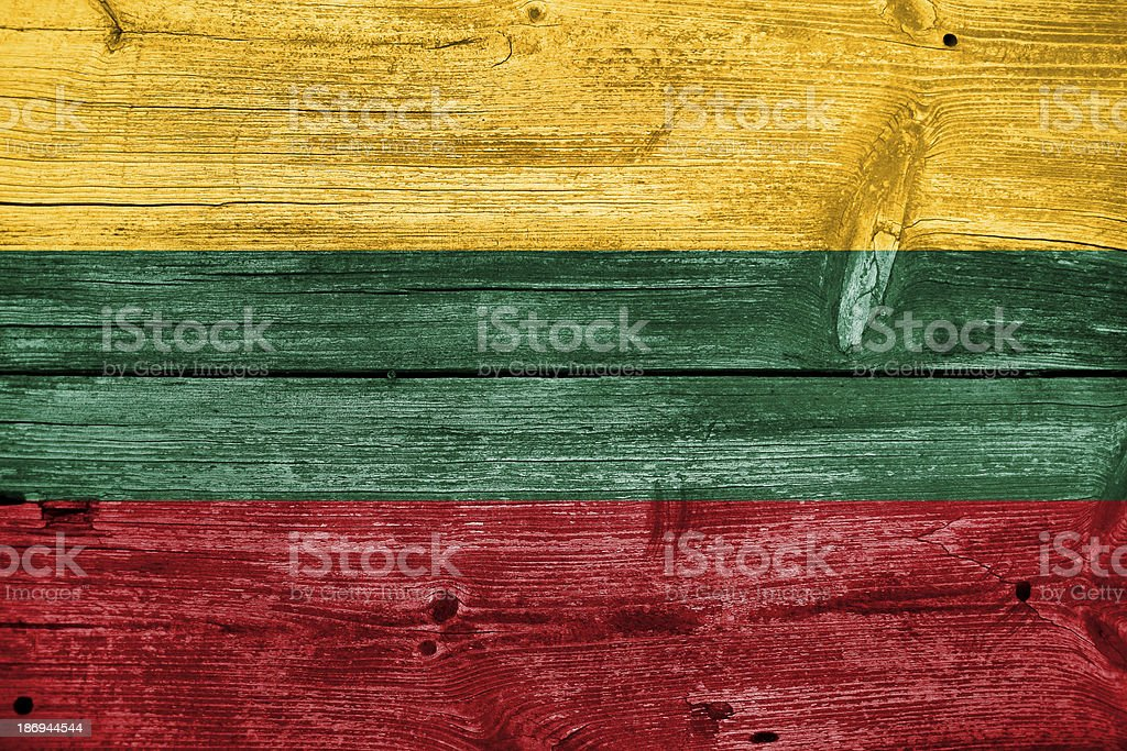 Lithuania Flag painted on old wood plank background royalty-free stock photo