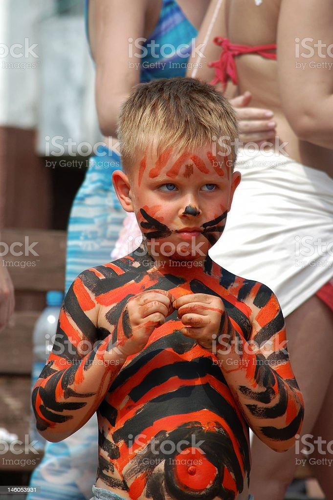 litle boy bodyart tiger on the beach royalty-free stock photo