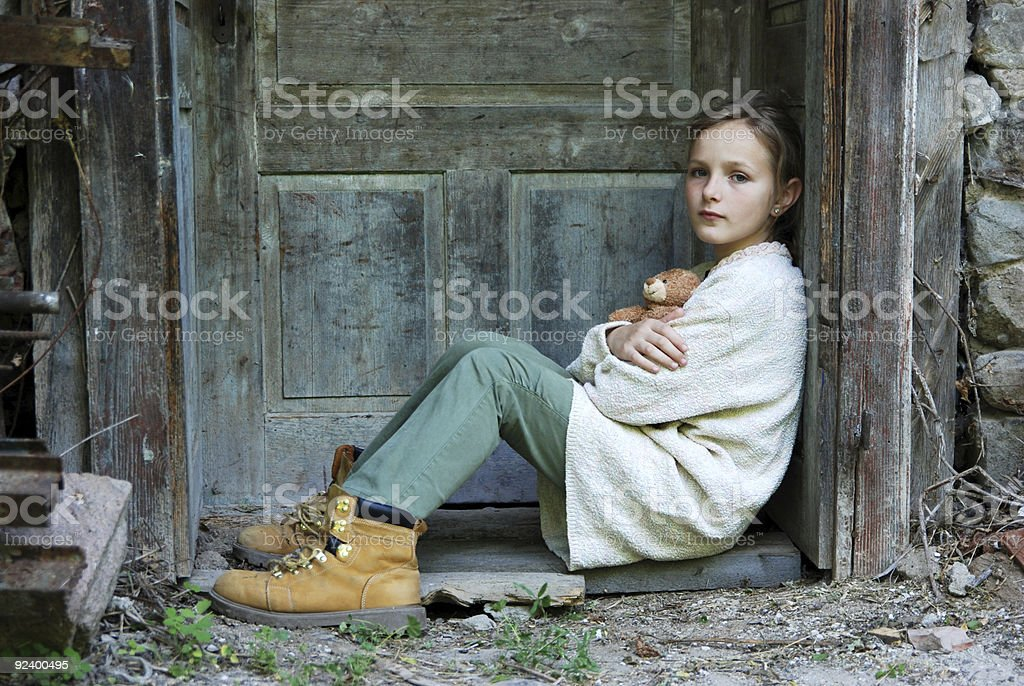 Litle sad girl stock photo