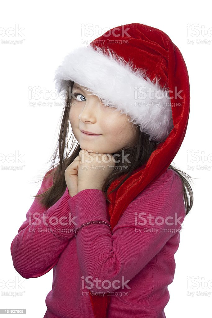 Litlle girl in a hat of Santa Claus stock photo