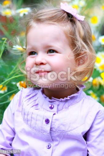 istock Litlle girl on meadow 171292011