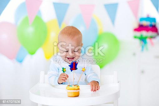 istock Litte boy celebrating first birthday 614707526