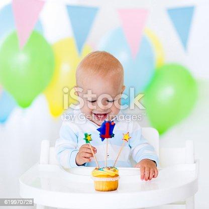 istock Litte boy celebrating first birthday 619970728