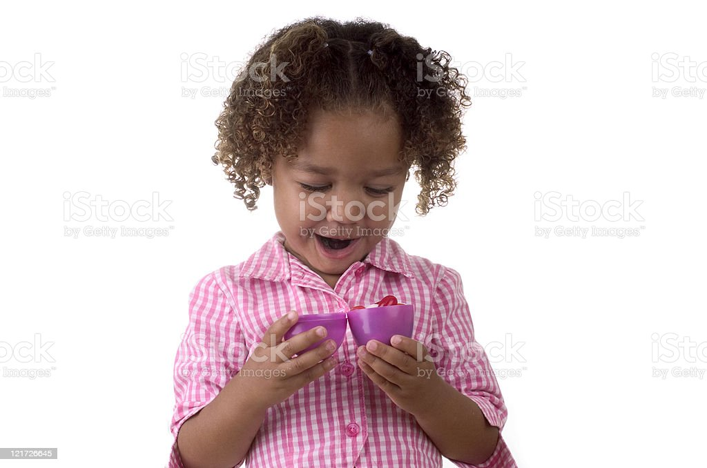Litte Girl Opening an Easter Egg royalty-free stock photo