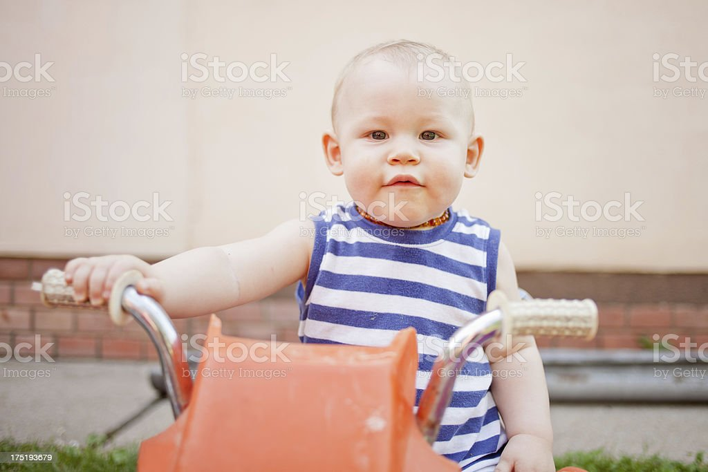 littel boy sitting on bicycle royalty-free stock photo