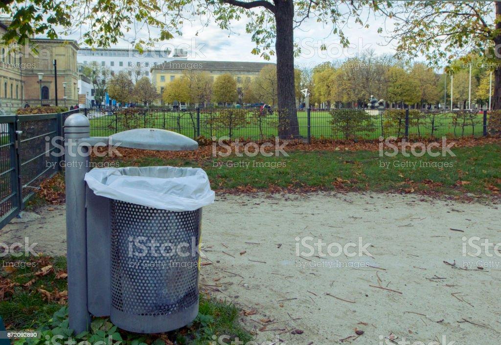 Munich, Germany - November 2, 2017: A litter bin in a park on the footpath / Grass near the Alte Pinakothek in Munich. stock photo