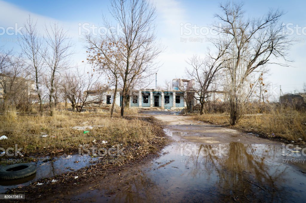 Littered abandoned city with ruined buildings stock photo