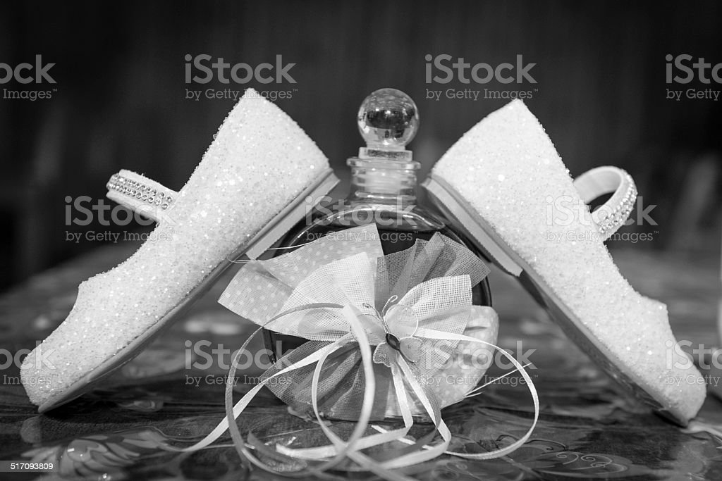 Litthe white baby shoes. stock photo