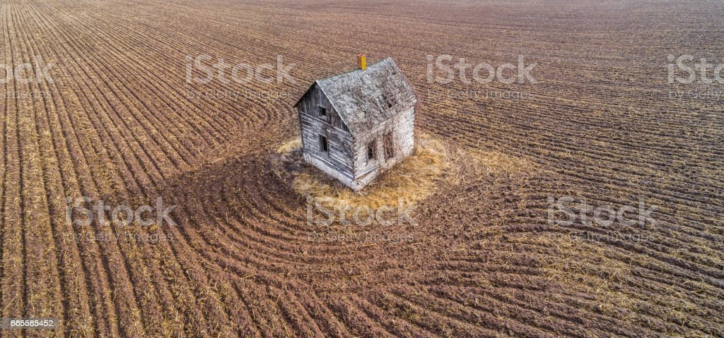 Little, abandoned, old house on an island in time. stock photo