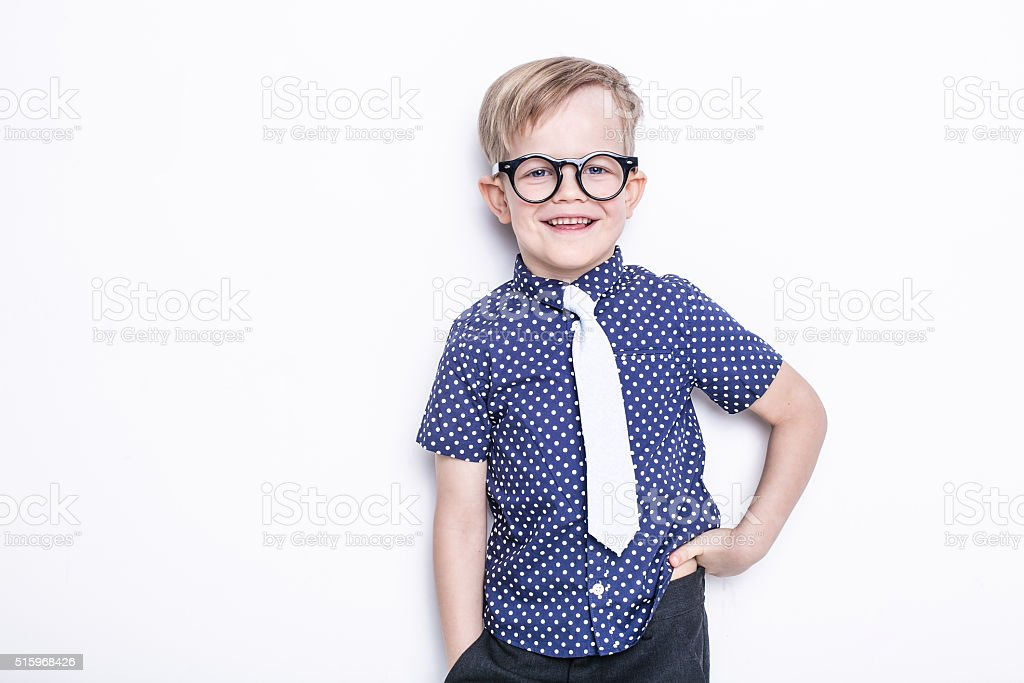 Little adorable kid in tie and glasses. School. Preschool. Fashion. stock photo