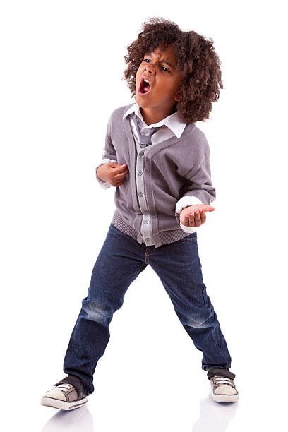 Little african american boy playing air guitar stock photo