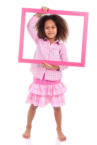 Little african american girl holding a picture frame stock photo
