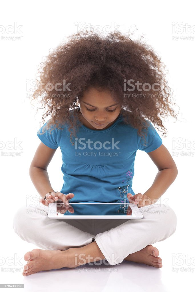 Little african asian girl using a tablet pc royalty-free stock photo