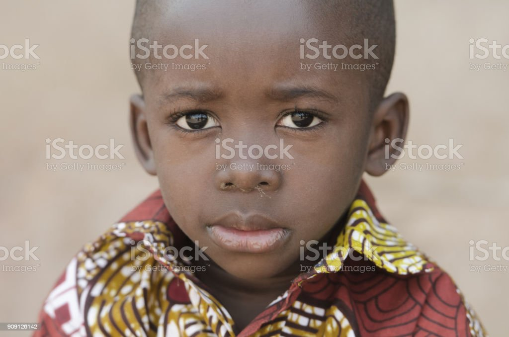 Little African Black Boy Looking Sad at Camera stock photo