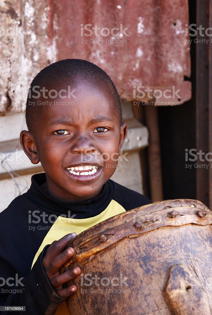 Little African boy with drum stock photo