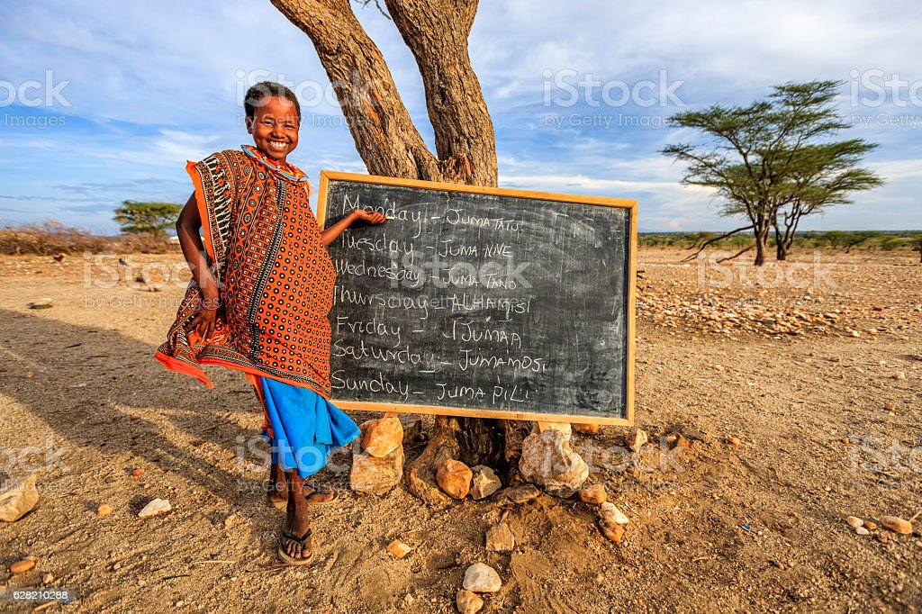 Little African girl during English class, East Africa stock photo