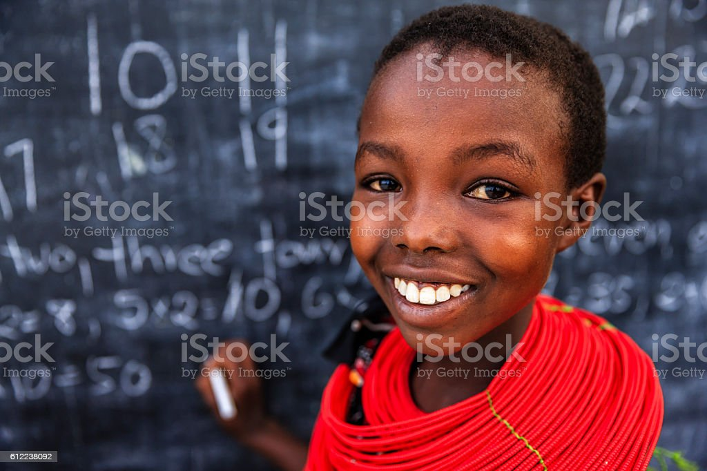 African children from Samburu tribe during math class in remote...