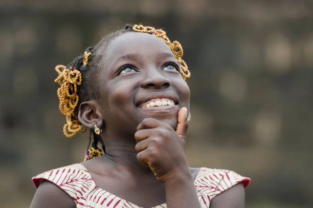 little african girl thinking about her future on the black continent - african culture stock photos and pictures