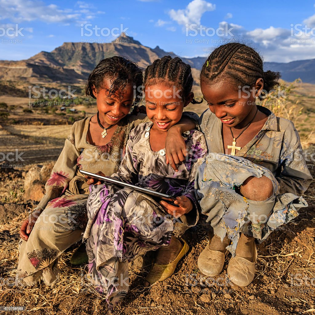 Little African girls using digital tablet, East Africa stock photo