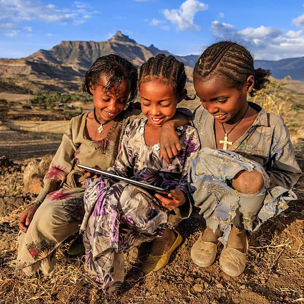 Little African girls using digital tablet, East Africa stock photo