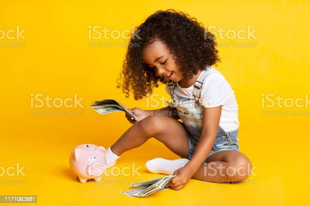 Little afro girl playing with money banknotes picture id1171062681?b=1&k=6&m=1171062681&s=612x612&h=mfu3jmu1f4cv8syr exsqsdwt9n03vm97qz37 pupyo=