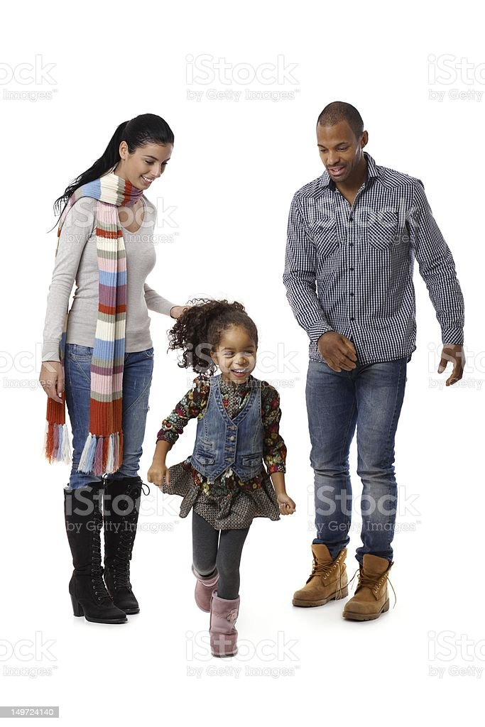 Little afro girl running parents watching royalty-free stock photo