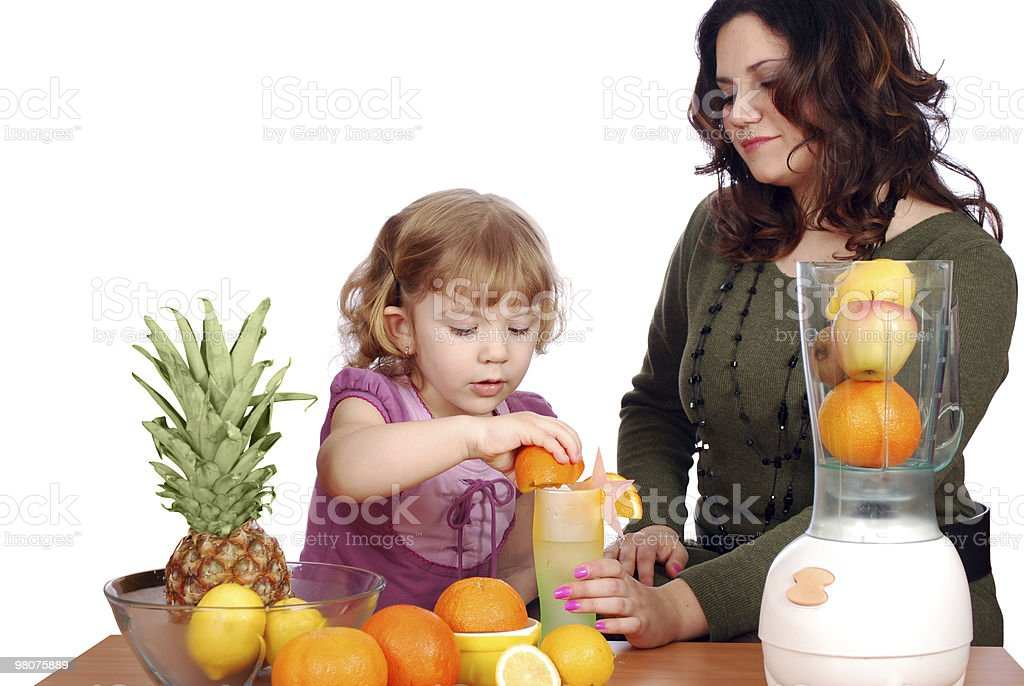 little and adult girl made fruit juice royalty-free stock photo