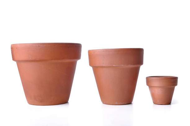 little and big  terra cotta pots stock photo