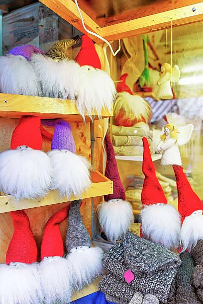 little angel and gnome statues at christmas market in riga - engelsflügel kaufen stock-fotos und bilder